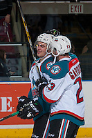 KELOWNA, CANADA - JANUARY 7: Brothers Reid Gardiner #23 and Erik Gardiner #12 of the Kelowna Rockets celebrate the shoot out win and their first game as teammates against the Kamloops Blazers on January 7, 2017 at Prospera Place in Kelowna, British Columbia, Canada.  (Photo by Marissa Baecker/Shoot the Breeze)  *** Local Caption ***