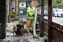 © Licensed to London News Pictures. 10/12/2015. Glenridding UK. A second huge clear up operation has started after the village of Glenridding in Cumbria flooded for a second time this week after the beck broke it's banks. Photo credit: Andrew McCaren/LNP