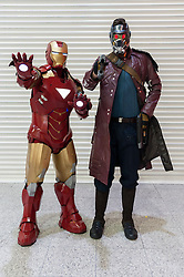 © Licensed to London News Pictures. 14/03/2015. Newham, London, UK.  Men dressed as Iron Man (left) and Star Lord (right) from Guardians of the Galaxy are amongst the many cosplayers attending the London Comic Con at the Excel Centre in Docklands. Photo credit : Stephen Chung/LNP