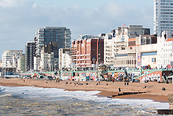 © Licensed to London News Pictures. 28/01/2016. Brighton, UK. People in Brighton take advantage of the sunny weather to spend some time on the beach. Today January 28th 2016. Photo credit: Hugo Michiels/LNP