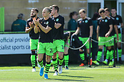 Forest Green Rovers players come out for the warm up during the EFL Sky Bet League 2 match between Forest Green Rovers and Grimsby Town FC at the New Lawn, Forest Green, United Kingdom on 17 August 2019.