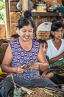 Making Cheroot, tradtional cigars, on Inle Lake, Burma.