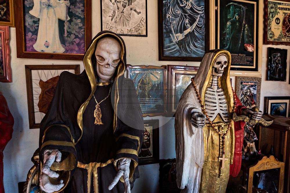 A shrine and offerings to Santa Muerte inside the La Casa De La Santa Muerte or House of the Saint of the Dead November 1, 2017 in Santa Ana Chapitiro, Michoacan, Mexico.