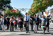New York City Mayor Bill de Blasio, center, marches in the Columbus Day Parade with New York State Comptroller Thomas DiNapoli, left, Public Advocate Letitia James, New York State Senator Jeffrey Klein, second from left, and New York State Assemblyman Jeff Dinowitz on Sunday, Oct. 11, 2015 in the Bronx, N.Y.