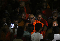 May 23, 2019 - Colombo, Sri Lanka - Sri Lankan General Secretary of the Bodu Bala Sena (BBS) Ven. Galagodaatte Gnanasara (C) leaves after meet with Buddhist spiritual leader Ittapana Dhammalankara Anu Nayake Maha Thero at the Rukmalgama Temple in Rukmalgama Near the Colombo on May 23, 2019. A firebrand Sri Lankan Buddhist monk serving a six-year jail term for contempt of court was freed on May 23 following a presidential pardon, Galagodaatte Gnanasara was driven out of the Welikada prison hospital where he had spent much of his sentence since his first imprisonment in June last year (Credit Image: © Pradeep Dambarage/ZUMA Wire)
