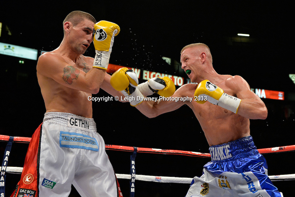 Terry Flanagan defeats Martin Gethin after Gethin's corner retired him in round seven. British Light Middleweight Title on 26th July 2014 at the Phones 4U Arena, Manchester. Promoted by Frank Warren. © Credit: Leigh Dawney Photography.