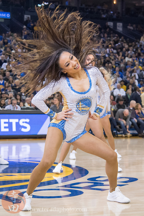January 8, 2018; Oakland, CA, USA; Golden State Warriors Dance Team dancer Hannie during the first quarter against the Denver Nuggets at Oracle Arena. The Warriors defeated the Nuggets 124-114.