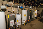 The hot water heaters at 47 West Washington Street are pictured during an energy audit on Tuesday, June 23, 2015.  Photo by Ohio University  /  Rob Hardin