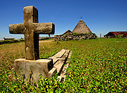 Christian grave in front of a trational home, Todo, Flores. Animist beliefs here comingle with organized religion.