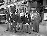 23/05/1957<br /> 05/23/1957<br /> 23 May 1957<br /> F.A.I. Youths team for tour of Germany. W. Whitnell, the team trainer is on the far right. The team on Cathal Brugha Street waiting for the bus to the airport.