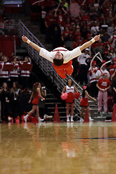14 February 2016: A male cheerleader does a hanging backflip during the Illinois State Redbirds v Bradley Braves at Redbird Arena in Normal Illinois (Photo by Alan Look)