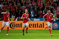 LILLE, FRANCE - Friday, July 1, 2016: Wales' captain Ashley Williams celebrates scoring his sides first goal, to make the score 1-1, during the UEFA Euro 2016 Championship Quarter-Final match against Belgium at the Stade Pierre Mauroy. Chris Gunter, Aaron Ramsey. (Pic by Paul Greenwood/Propaganda)