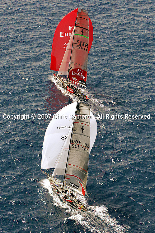 Emirates Team New Zealand NZL92 leads the way against Alinghi SUI100 down the last run to win race two of the 32nd America`s Cup in Valencia, Spain on Sunday 24 June 2007. Team New Zealand won the match by 28 seconds. Photo : Chris Cameron/PHOTOSPORT