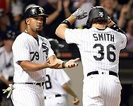 CHICAGO - AUGUST 01:  Jose Abreu #79 and Kevan Smith #36 of the Chicago White Sox celebrate after Smith hit a two-run home run against the Toronto Blue Jays on August 1, 2017 at Guaranteed Rate Field in Chicago, Illinois.    (Photo by Ron Vesely) Subject:   Jose Abreu; Kevan Smith