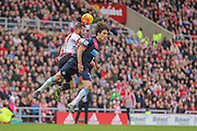 Sunderland forward Steven Fletcher and Newcastle United defender Fabricio Coloccini battle for the header  during the Barclays Premier League match between Sunderland and Newcastle United at the Stadium Of Light, Sunderland, England on 25 October 2015. Photo by Simon Davies.