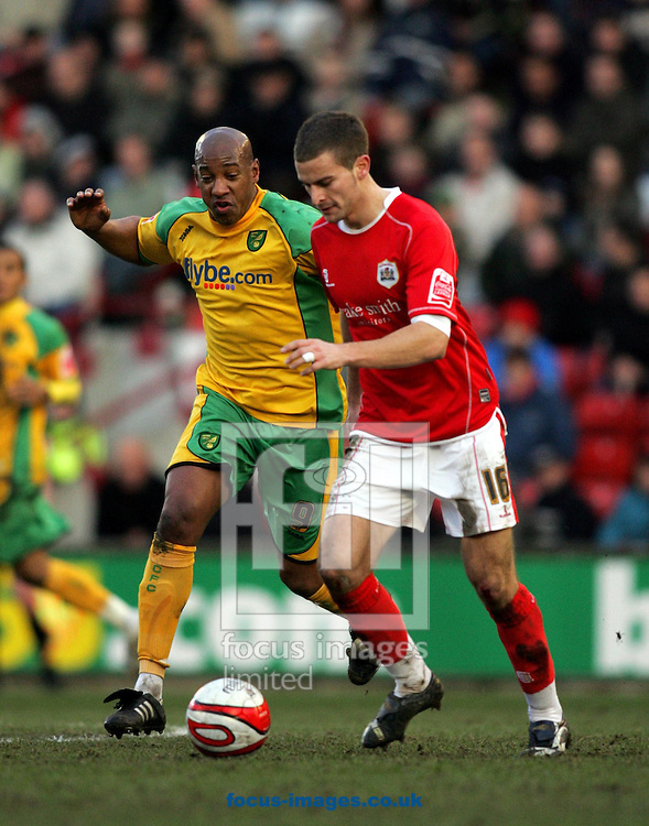 London - Saturday, January 12th, 2008: Stephen Foster of Barnsley and Dion Dublin of Norwich City during the Coca Cola Champrionship match at Oakwell, Barnsley. (Pic by Paul Hollands/Focus Images)