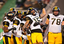 Nov 25, 2017; Huntington, WV, USA; Southern Miss Golden Eagles wide receiver Allenzae Staggers (15) celebrates with teammates after scoring a touchdown during the fourth quarter against the Marshall Thundering Herd at Joan C. Edwards Stadium. Mandatory Credit: Ben Queen-USA TODAY Sports