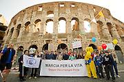 2013/05/12 Roma, terza Marcia Nazionale per la Vita, contro l'aborto e l'eutanasia. Nella foto un gruppo di manifestanti ai piedi del Colosseo..Third National March for Life, organized by association against abortion and euthanasia. In the picture a group of protesters at Coliseum - © PIERPAOLO SCAVUZZO