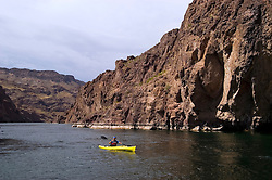 Kayaking, no model release, on the Colorado River below Hoover Dam on border of Arizona, AZ, Nevada, NV, tourism, vacation, sports, action, landscape, image nv423-18499.Photo copyright: Lee Foster, www.fostertravel.com, lee@fostertravel.com, 510-549-2202