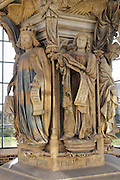 David, wearing a crown and holding a harp and psalm, and Jeremiah, holding a book with phylactery, from the Puits de Moise, or Well of Moses, 1395-1403, sculpted by Claus Sluter, 1340-1406, and his studio, and painted by Jean Malouel, 1365-1415, in the courtyard of the Chartreuse de Champmol, the burial site of Philippe le Hardi duc de Bourgogne, or Philip the Bold Duke of Burgundy, now the Hospital de la Chartreuse, Dijon, Burgundy, France. The sculpture was commissioned by Jean sans Peur or John the Fearless, and consists of a crucifixion scene surrounded by 6 prophets (Moses, David, Jeremiah, Zachariah, Daniel and Isaiah), with 6 weeping angels. The hexagonal building surrounding the sculpture was added in the 17th century. Picture by Manuel Cohen