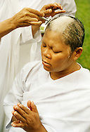 Every other Sunday there is a nun ordination at Sathira-Dhammasathan. A Thai nun has her head and eyebrows shaved, dress in white and do not take any meals after noon. She is called a Mae Chee...Photographer: Elin Berge / MOMENT