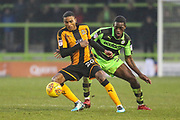 Cambridge United's Jevani Brown(20) holds off Forest Green Rovers Isaiah Osbourne(34) during the EFL Sky Bet League 2 match between Forest Green Rovers and Cambridge United at the New Lawn, Forest Green, United Kingdom on 20 January 2018. Photo by Shane Healey.