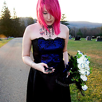 Nicole MacNeil uses her  iphone after her wedding at a cemetery in Sheffield Pa. on Halloween evening (10/31/08) photo by Mark L. Anderson