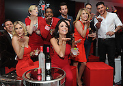 "The original Skinnygirl Bethenny Frankel, center, strikes a pose with fellow ""Real Housewives of New York"" cast members Kristen Taekman, left, and Ramona Singer, center right, and friends at the ""Boy Meets Skinnygirl Cocktails"" Valentine's Launch Party on Tuesday, Feb. 10, 2015 in New York. The group joined Frankel as she unveiled new Skinnygirl Spicy Lime Margarita and Skinnygirl Pinot Noir at the event to benefit Dress for Success. (Photo by Diane Bondareff/Invision for Skinnygirl Cocktails/AP Images)"