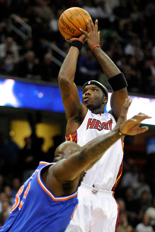 Feb 4, 2010; Cleveland, OH, USA; Miami Heat center Jermaine O'Neal (7) shoots over Cleveland Cavaliers center Shaquille O'Neal (33) during the third quarter at Quicken Loans Arena. The Cavaliers beat the Heat 102-86. Mandatory Credit: Jason Miller-US PRESSWIRE