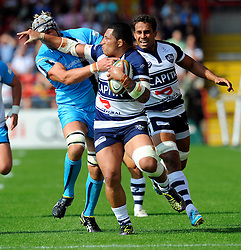 Bristol Prop Anthony Perenise evades the tackle of Worcester Inside Centre Andy Symons - Photo mandatory by-line: Joe Meredith/JMP - Mobile: 07966 386802 - 7/09/14 - SPORT - RUGBY - Bristol - Ashton Gate - Bristol Rugby v Worcester Warriors - The Rugby Championship