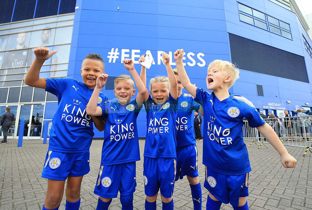 Young Brighton and Hove Albion fans before the Premier League match at the King Power Stadium, Leicester.