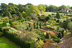 Overhead view of the Peacock and High Garden at Great Dixter showing structure provided by yew hedges
