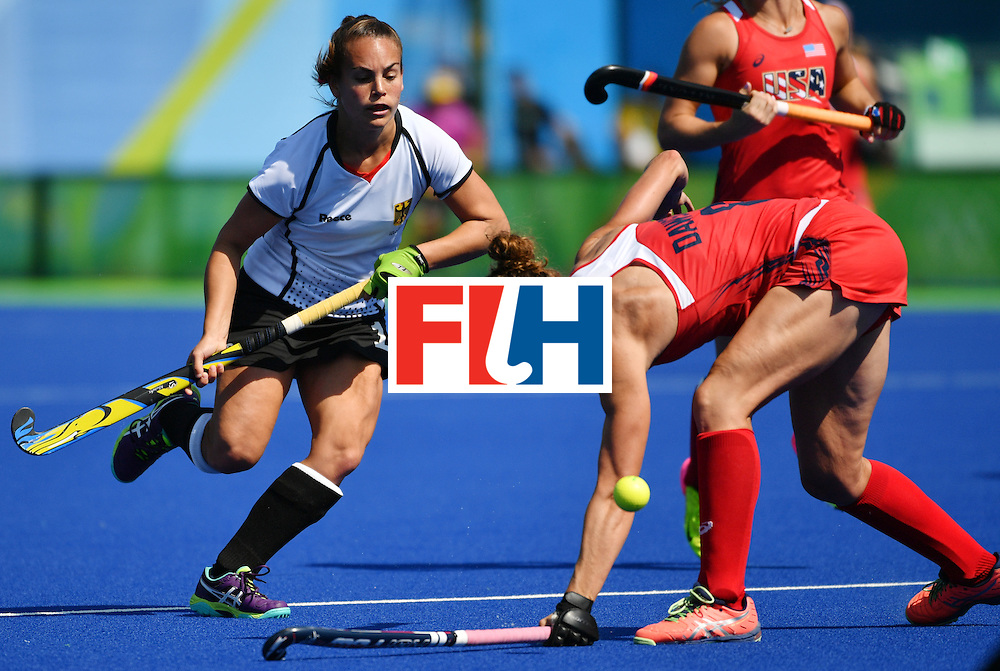 Germany's Lisa Altenburg (L) vies with The USA's Rachel Dawson during the women's quarterfinal field hockey USA vs Germany match of the Rio 2016 Olympics Games at the Olympic Hockey Centre in Rio de Janeiro on August 15, 2016. / AFP / Pascal GUYOT        (Photo credit should read PASCAL GUYOT/AFP/Getty Images)