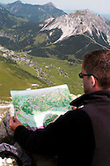 Liechtenstein  Malbun  June 2008.Small town high in the Alpine (southeastern)..Fürstin-Gina-Weg' (Princess Gina memorial trail)..Tourist looks at the map on top of the Augstenberg (2359 m),....
