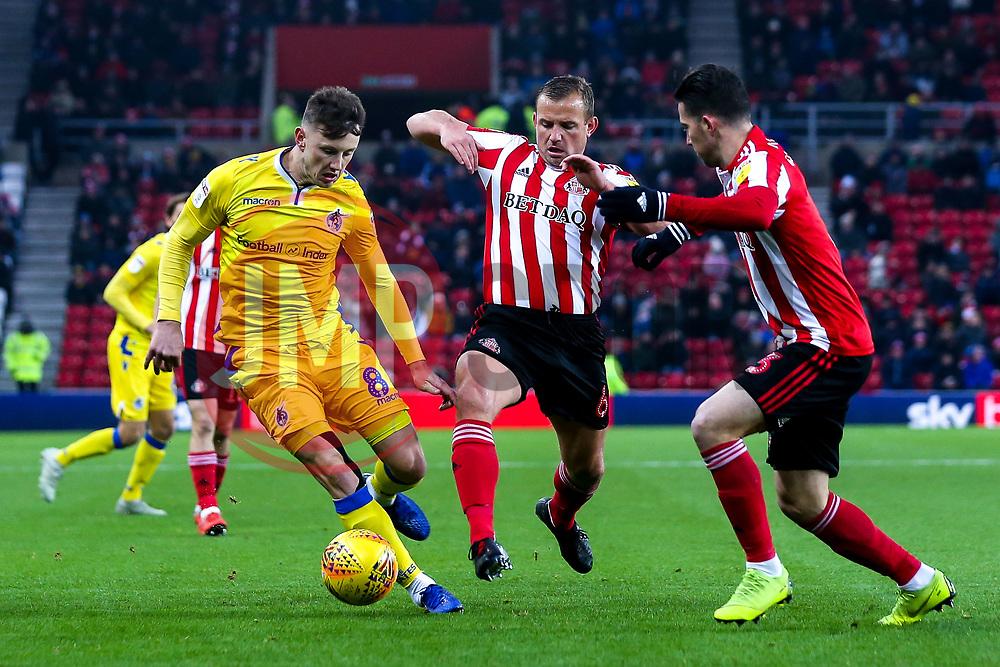Ollie Clarke of Bristol Rovers takes on Lee Cattermole and Bryan Oviedo of Sunderland - Mandatory by-line: Robbie Stephenson/JMP - 15/12/2018 - FOOTBALL - Stadium of Light - Sunderland, England - Sunderland v Bristol Rovers - Sky Bet League One