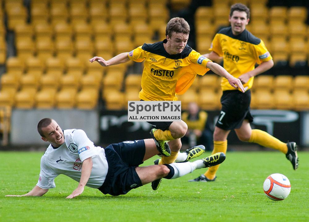 Falkirk's Mark Millar brings down Stefan Scougall, Livingston v Falkirk, SFL Division 1