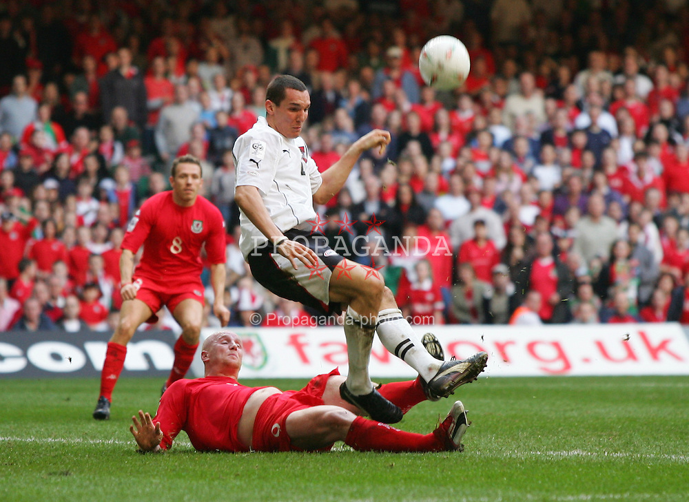 CARDIFF, WALES - SATURDAY MARCH 26th 2005: Wales' John Hartson and Austria's Emanuel Pogatez during the Wold Cup Qualifying match at the Millennium Stadium. (Pic by David Rawcliffe/Propaganda)