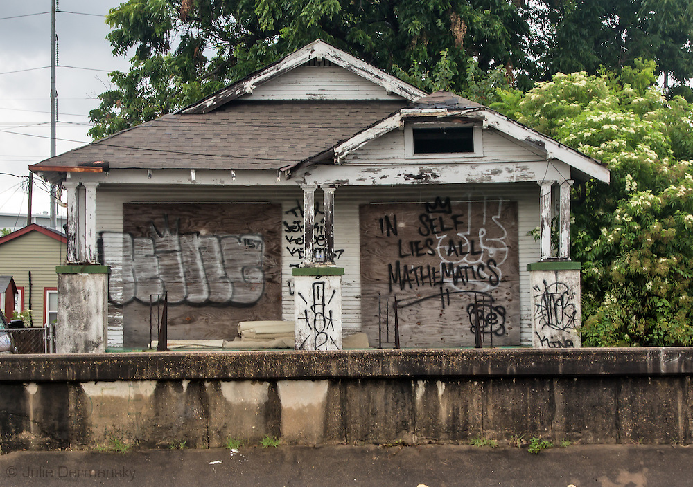 Blighted home on the banks of one of New Orleans many canals, nearly 10 years after Hurricane Katrina.