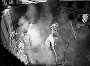 16-17/12/1959<br /> 12/16-17/ 1959<br /> 16-17 December 1959<br /> Distillery at Powers Dublin. Workers stripped to the waist cleaning out mash from which worts has been extracted. They work in a steam filled mash tun at temperatures approximately 120F.