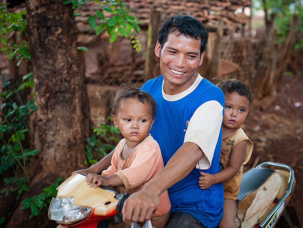 Father with two sons on motorbike (Vietnam)