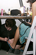 Models preparing for Baby Phat Show at Radio City Music Hall backstage