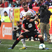 Nick DeLeon, D.C. United, is challenged by Jonathan Steele, New York Red Bulls, in action during the New York Red Bulls V D.C. United, Major League Soccer regular season match at Red Bull Arena, Harrison, New Jersey. USA. 16th March 2013. Photo Tim Clayton