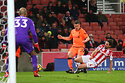 Liverpool's James Milner is tackled by Stoke City's Joe Allen during the Premier League match between Stoke City and Liverpool at the Bet365 Stadium, Stoke-on-Trent, England on 29 November 2017. Photo by John Potts.