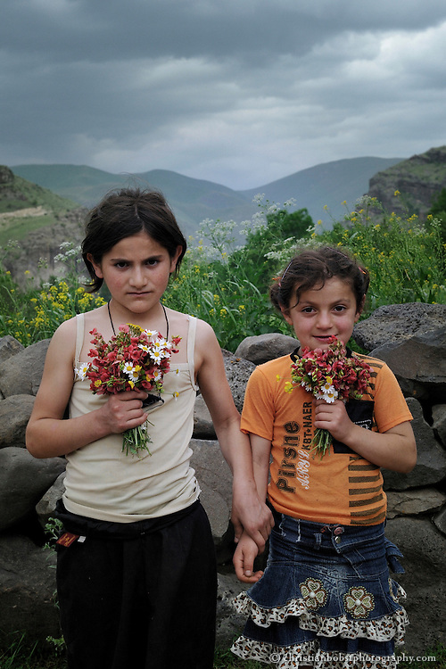 Sisters with flowers in Mirashkhani.