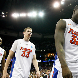 Mar 26, 2011; New Orleans, LA; Florida Gators players Vernon Macklin (32), Erik Murphy (33) and Will Yeguete (15) walk off the court following a loss to the Butler Bulldogs in the semifinals of the southeast regional of the 2011 NCAA men's basketball tournament at New Orleans Arena. Butler defeated Florida 74-71.  Mandatory Credit: Derick E. Hingle