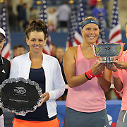 Andrea Hlavackova, (right) and Lucie Hradecka, Czech Republic, with the Women's Doubles Trophy after beating Casey Dellacqua, (second left), and Ashleigh Barty, Australia,  during the Women's Doubles Final at the US Open. Flushing. New York, USA. 7th September 2013. Photo Tim Clayton