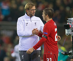 LIVERPOOL, ENGLAND - Thursday, November 26, 2015: Liverpool's manager Jürgen Klopp hugs Lucas Leiva after the 2-1 victory over FC Girondins de Bordeaux during the UEFA Europa League Group Stage Group B match at Anfield. (Pic by David Rawcliffe/Propaganda)