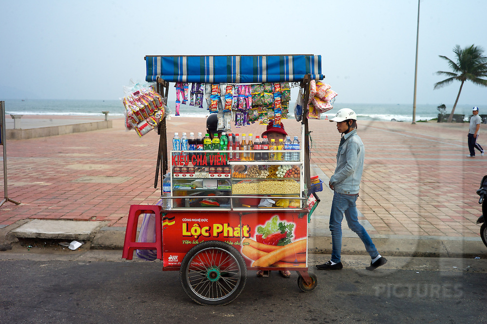 A fully stocked food cart set up along China beach, Danang, Vietnam, Southeast Asia