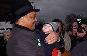 Rev Jesse Jackson with Ken Livingstone's baby, Thomas Beal, ( Livingstone?) Anti War Rally, Hyde Park. 15 February 2003. © Copyright Photograph by Dafydd Jones 66 Stockwell Park Rd. London SW9 0DA Tel 020 7733 0108 www.dafjones.com