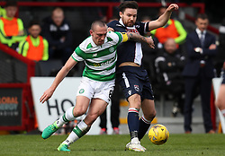 Celtic's Scott Brown and Ross County's Ryan Dow (right) battle for the ball during the Ladbrokes Scottish Premiership match at the Global Energy Stadium, Dingwall.